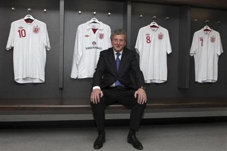 Newly appointed England soccer manager Roy Hodgson poses for a photograph in the home dressing room at Wembley Stadium in London