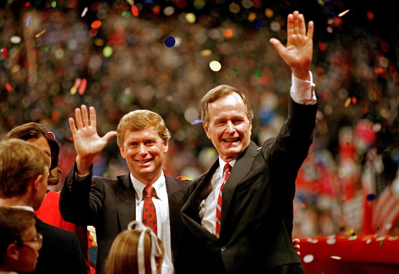 FILE - In this Aug. 18, 1988 file photo, Republican presidential candidate, Vice President George H.W. Bush, right, and his running mate Sen. Dan Quayle, R-Ind., wave to the assembly of the Republican National Convention in New Orleans after their acceptance speeches for the presidential and vice-presidential nomination. Long gone are the passionate debates. Long gone is the suspense about who will emerge as the party's presidential nominee. Political conventions now are carefully scripted pep rallies aimed at a national TV audience. Not since the 1970s, in fact, has the nation had a major-party national convention begin with the nominee in doubt. Americans already know how the story will end at this year's Republican and Democratic national gatherings. So have modern-day conventions become irrelevant? (AP Photo/J. Scott Applewhite, File)