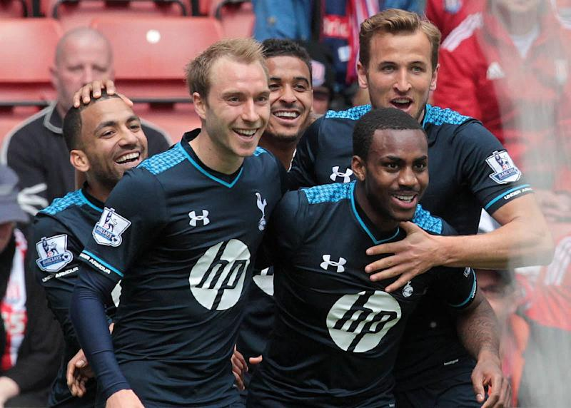 Tottenham Hotspur's English defender Danny Rose (2-R) celebrates after scoring his team's first goal during the English Premier League football match between Stoke City and Tottenham Hotspur on April 26, 2014