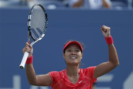 Li Na of China celebrates after defeating Makarova of Russia at the U.S. Open tennis championships in New York
