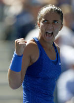 Sara Errani, of Italy, reacts after a point against Venus Williams, of the United States, during the third round of the 2014 U.S. Open tennis tournament, Friday, Aug. 29, 2014, in New York. (AP Photo/Matt Rourke)