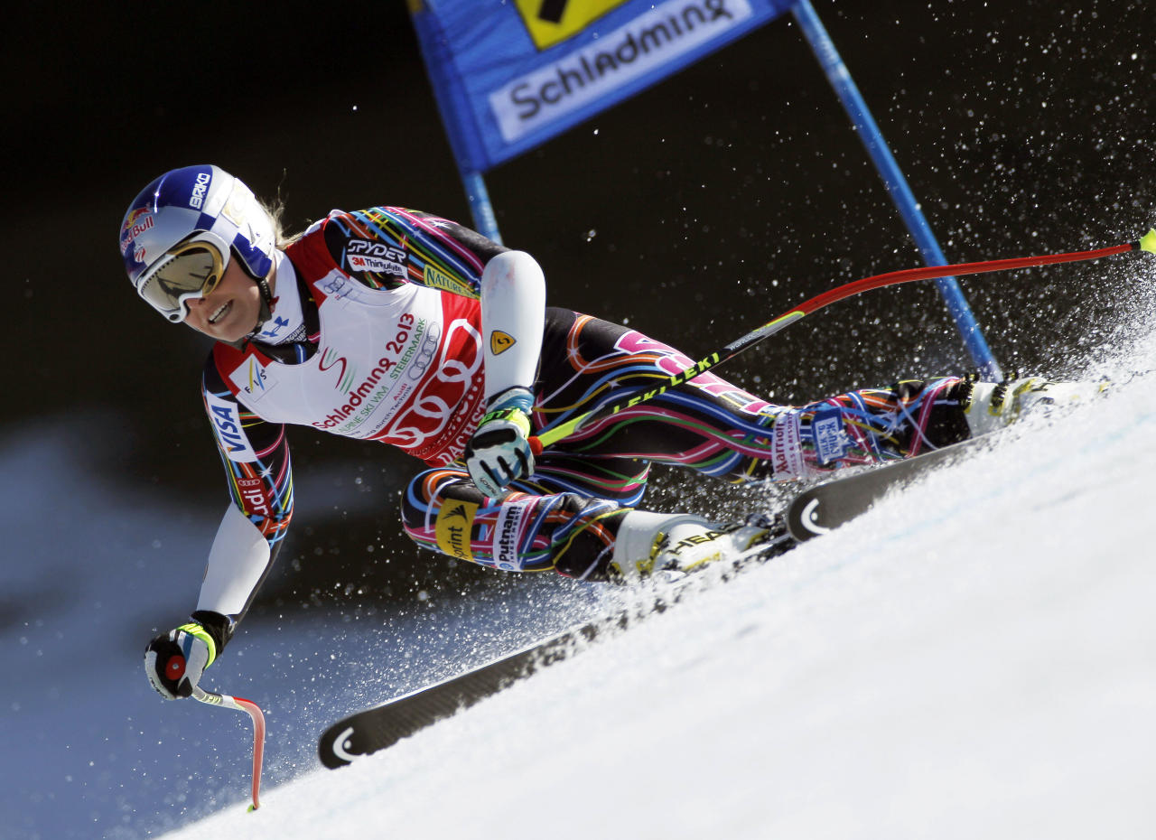 Lindsey Vonn, of the United States, speeds down the course during an alpine ski, women's World Cup super-G, in Schladming, Austria, Thursday, March 15, 2012. Vonn won the World Cup super-G title Thursday after narrowly avoiding skiing out and finishing sixth in the final race of the season. (AP Photo/Shinichiro Tanaka)