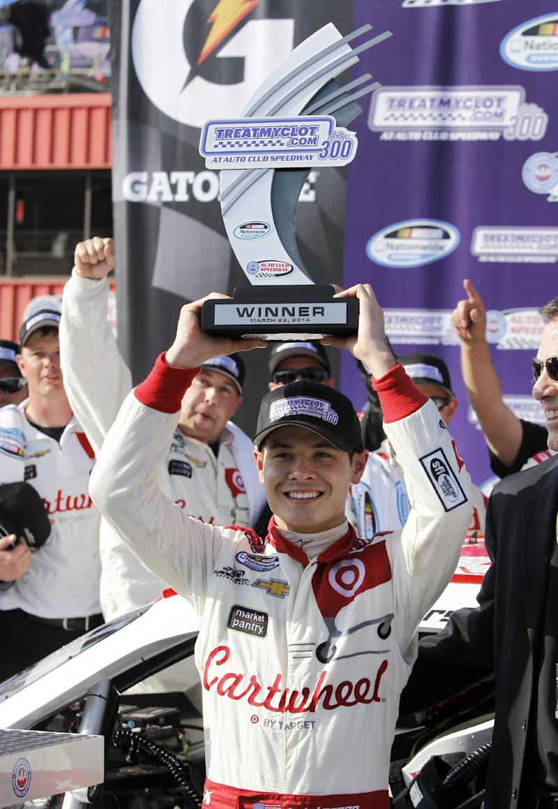 Larson gets 1st Nationwide win, holds off Harvick