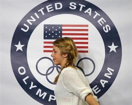 Wagner walks offstage after being introduced as part of the U.S.' women's figure skating team for the upcoming Sochi Winter Olympics during a news conference in Boston