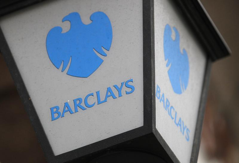 A lamp featuring a logo of Barclay's bank is seen outside a branch in London