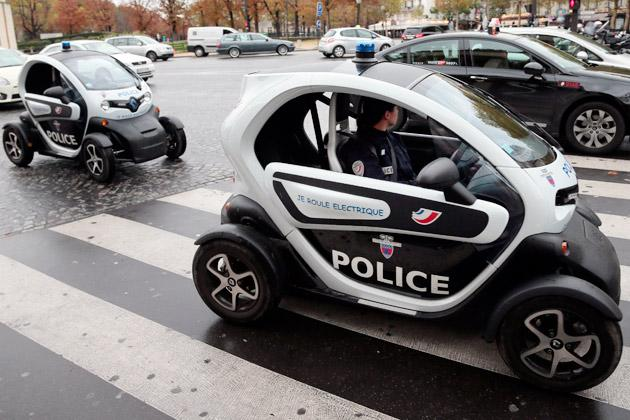 Policemen drive Renault Twizy electric cars in the street on the Trocadero square in Paris.