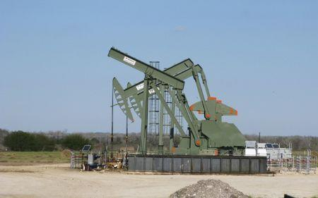 Oil prices claw back losses, but oversupply still weighs