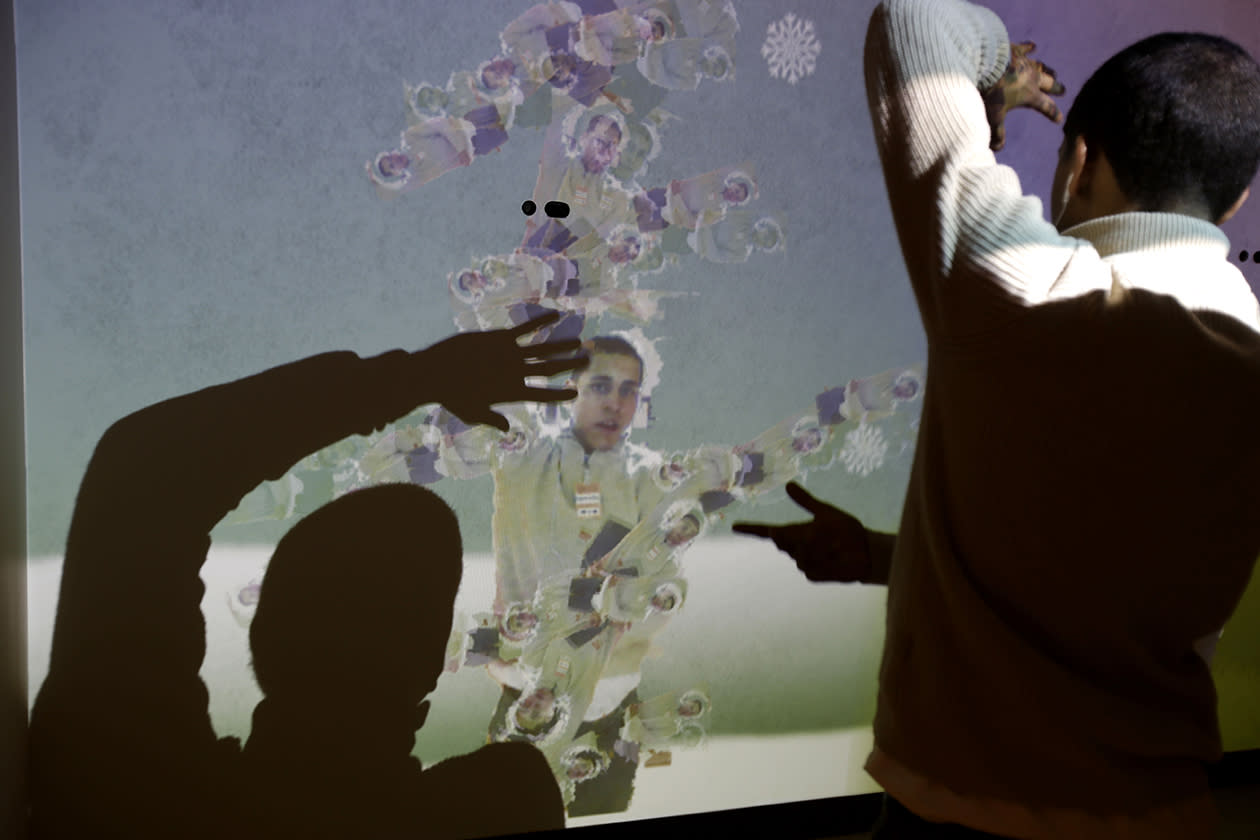 "Bronx Preparatory Charter School student Pablo Flores experiments with an exhibit called the ""Human Tree"" at the new National Museum of Mathematics."