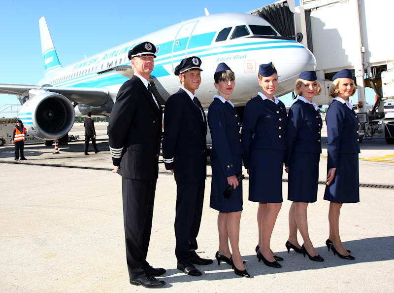 MILAN, ITALY - SEPTEMBER 16:  The Cabin Crew of Finnair wearing old style uniforms attend Finnair 85th Anniversary Celebration at Malpensa Airport on September 16, 2008 in Milan, Italy.  (Photo by Vittorio Zunino Celotto/Getty Images)
