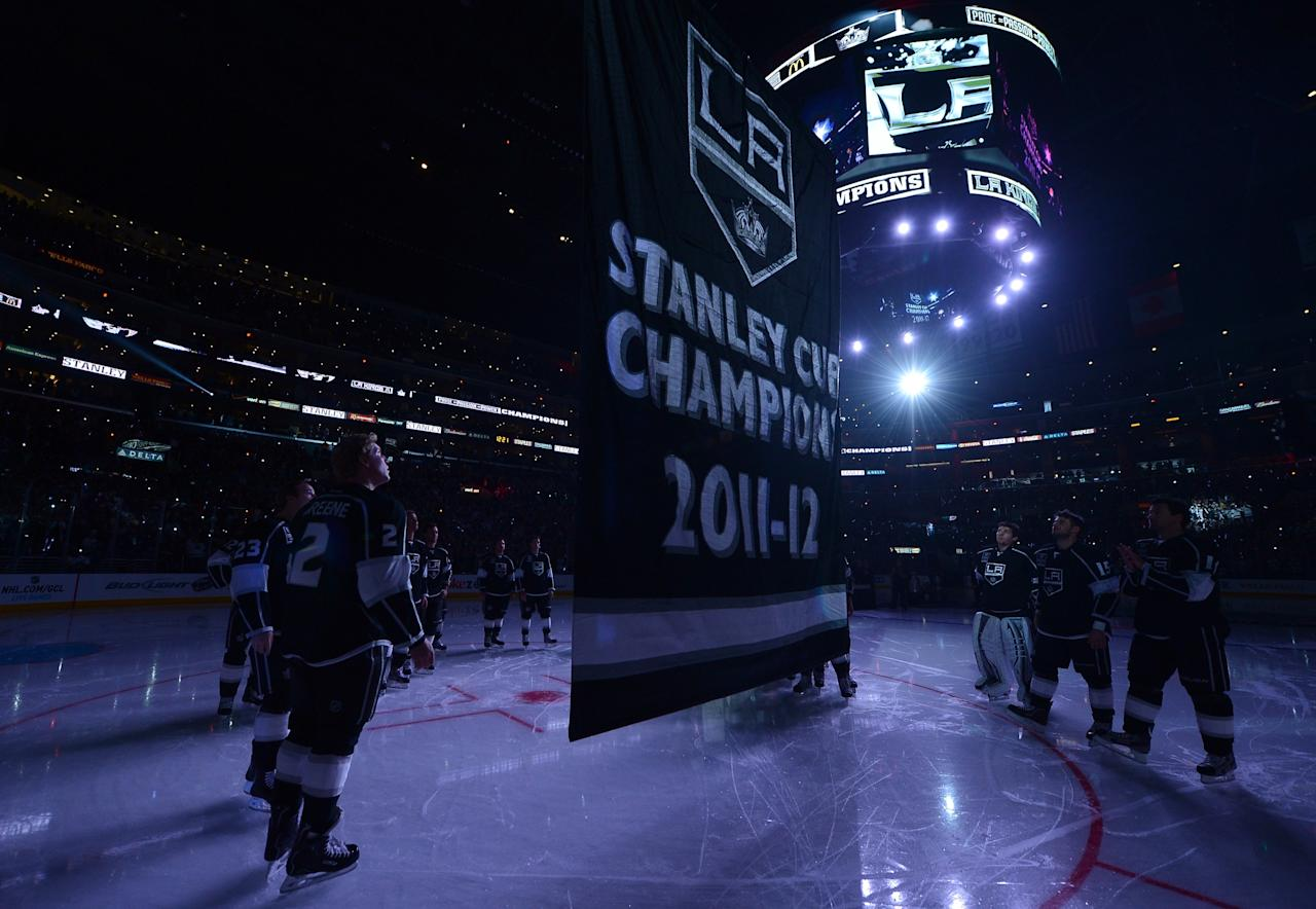 LOS ANGELES, CA - JANUARY 19:  The Los Angeles Kings 2001-12 Stanley Cup banner is raised during a ceremony before the NHL season opening game against the Chicago Blackhawks at Staples Center on January 19, 2013 in Los Angeles, California.  (Photo by Harry How/Getty Images)