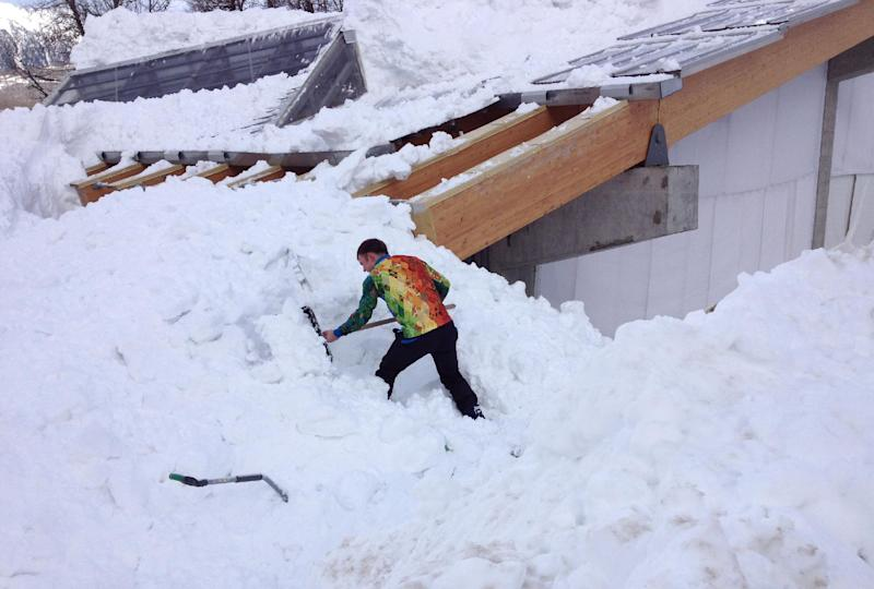 Olympic workers fall from roof while clearing snow