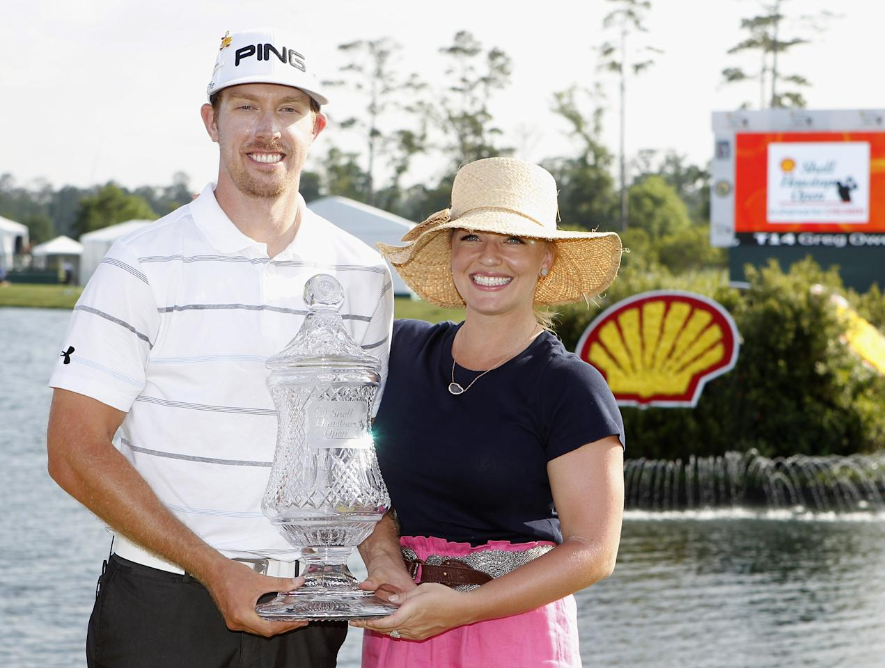 HUMBLE, TX - APRIL 01:  Hunter Mahan holds the winners trophy with his wife, Kandi, on the green of the 18th hole after the final round of the Shell Houston Open at Redstone Golf Club on April 1, 2012 in Humble, Texas.  (Photo by Matt Sullivan/Getty Images)