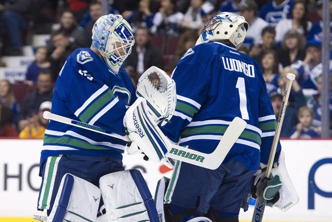 VANCOUVER, CANADA - MARCH 3: Goalie Roberto Luongo #1 of the Vancouver Canucks is replaced by Cory Schneider #35 during the first period in NHL action against the Buffalo Sabres on March 03, 2012 at Rogers Arena in Vancouver, BC, Canada.  (Photo by Rich Lam/Getty Images)