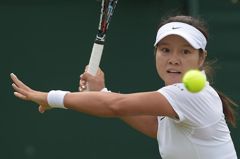 China's Li Na returns against Austria's Yvonne Meusburger during their women's singles second round match on day three of the 2014 Wimbledon Championships at The All England Tennis Club in Wimbledon, southwest London, on June 25, 2014