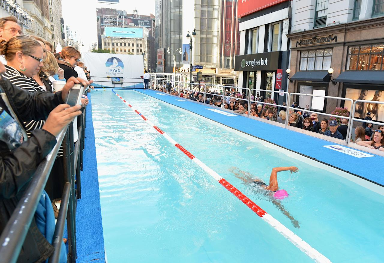 "NEW YORK, NY - OCTOBER 08: Long-distance swim legend Diana Nyad, fresh off her record-braking swim from Cuba to florida swims at day 1 of ""Swim For Relief"" Benefiting Hurricane Sandy Recovery at Herald Square on October 8, 2013 in New York City. (Photo by Slaven Vlasic/Getty Images)"
