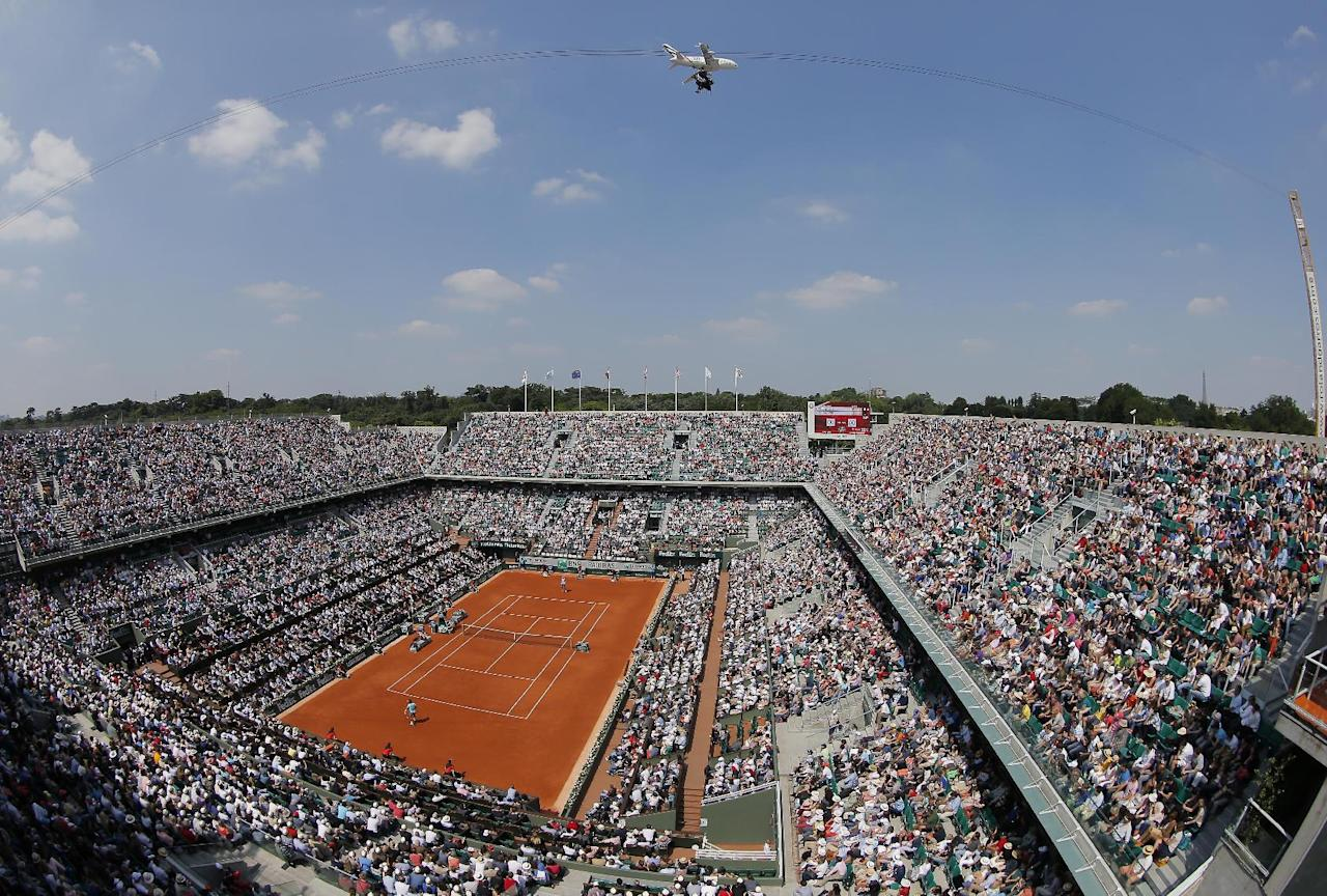 The crowd watches Spain's Rafael Nadal facing Argentina's Leonardo Mayer on court Philippe Chatrier, known as center court, during their third round match of  the French Open tennis tournament at the Roland Garros stadium, in Paris, France, Saturday, May 31, 2014. (AP Photo/Michel Spingler)