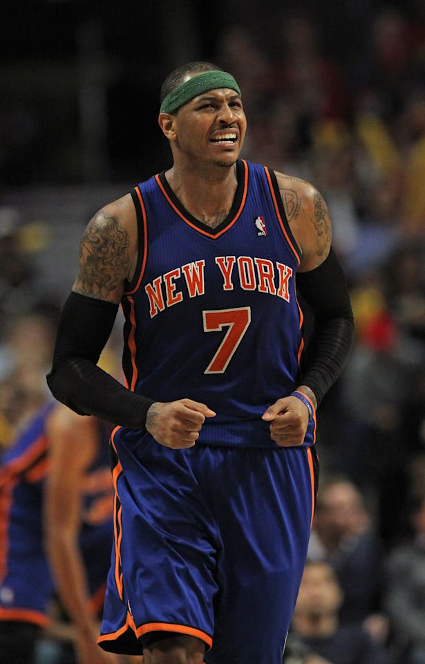 CHICAGO, IL - APRIL 10: Carmelo Anthony #7 of the New York Knicks reacts after turning the ball over against the Chicago Bulls at the United Center on April 10, 2012 in Chicago, Illinois. The Bulls defeated the Knicks 98-86. NOTE TO USER: User expressly acknowledges and agrees that, by downloading and or using this photograph, User is consenting to the terms and conditions of the Getty Images License Agreement. (Photo by Jonathan Daniel/Getty Images)