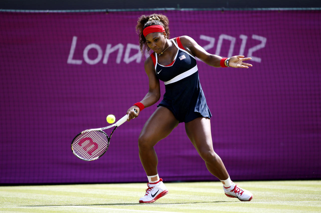 LONDON, ENGLAND - JULY 30:  Serena Williams of the United States plays a forehand during the Women's Singles Tennis match against Urszula Radwanska of Poland on Day 3 of the London 2012 Olympic Games at the All England Lawn Tennis and Croquet Club in Wimbledon on July 30, 2012 in London, England.  (Photo by Jamie Squire/Getty Images)