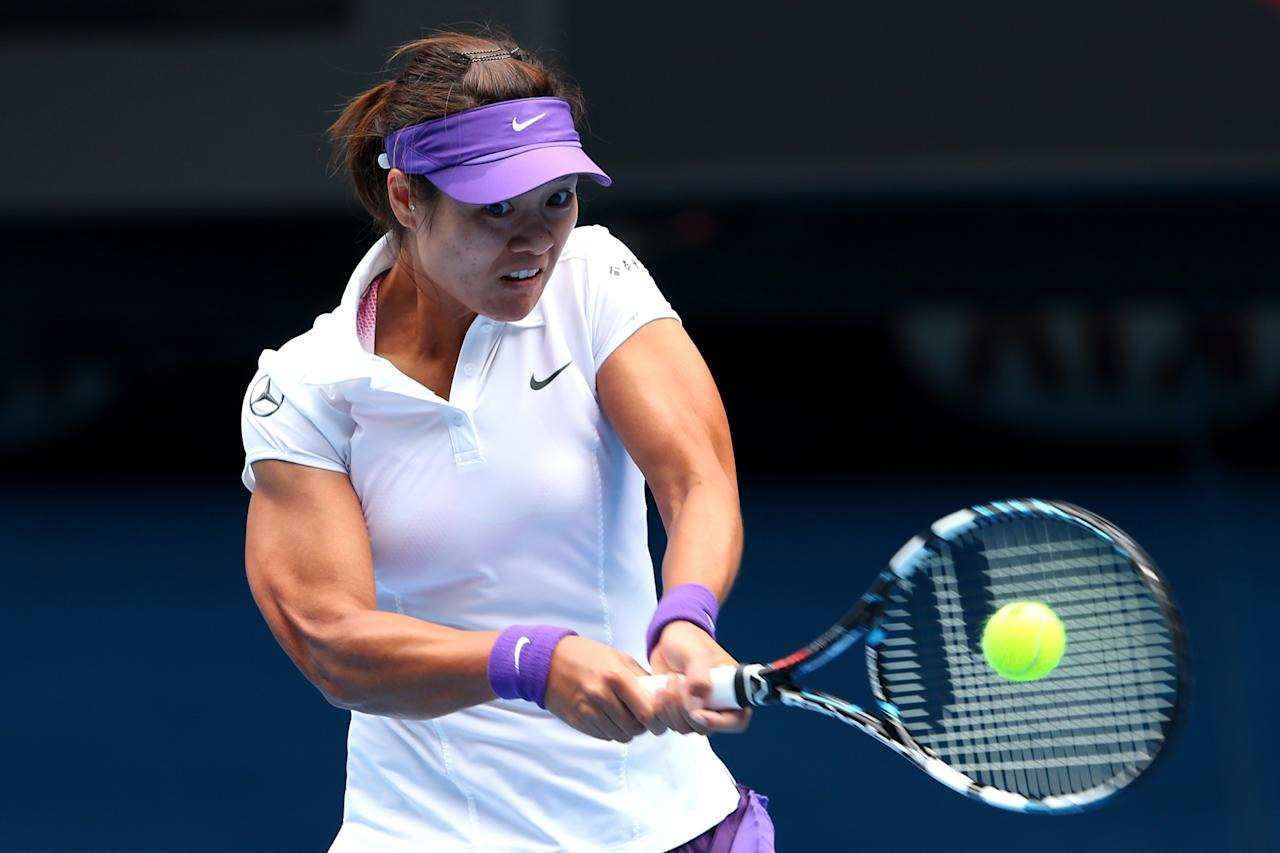 MELBOURNE, AUSTRALIA - JANUARY 22:  Na Li of China plays a backhand in her Quarterfinal match against Agnieszka Radwanska of Poland during day nine of the 2013 Australian Open at Melbourne Park on January 22, 2013 in Melbourne, Australia.  (Photo by Cameron Spencer/Getty Images)