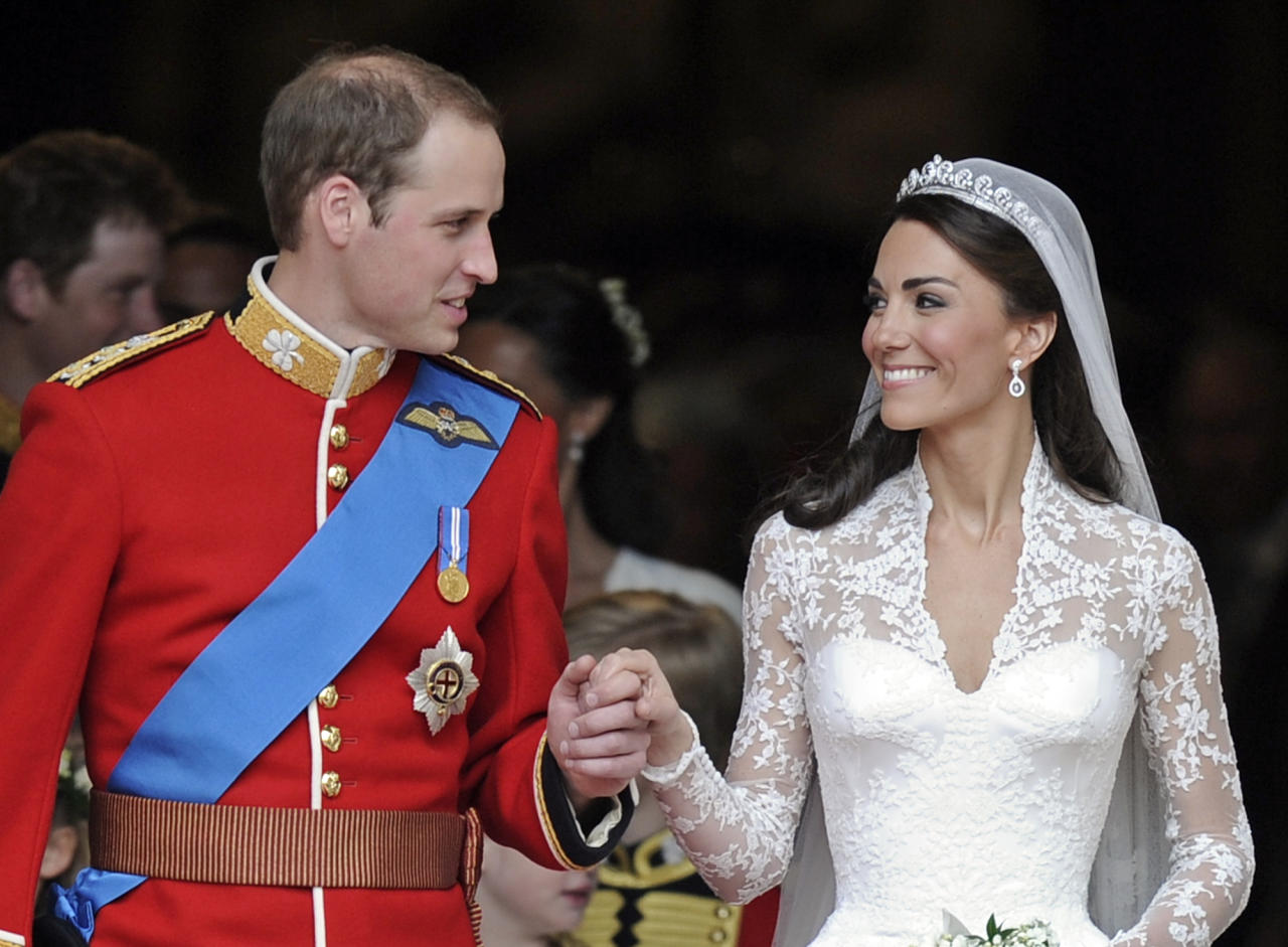 FILE - In this April 29, 2011 file photo, Britain's Prince William and his wife Kate, Duchess of Cambridge stand outside of Westminster Abbey after their Royal Wedding in London. The couple celebrate their first anniversary on Sunday. (AP Photo/Martin Meissner, File)