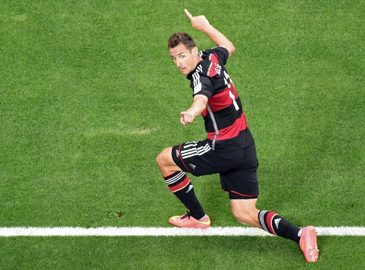 Germany's Miroslav Klose celebrates scoring his side's 2nd goal during the World Cup semifinal soccer match between Brazil and Germany at the Mineirao Stadium in Belo Horizonte, Brazil, Tuesday, July 8, 2014