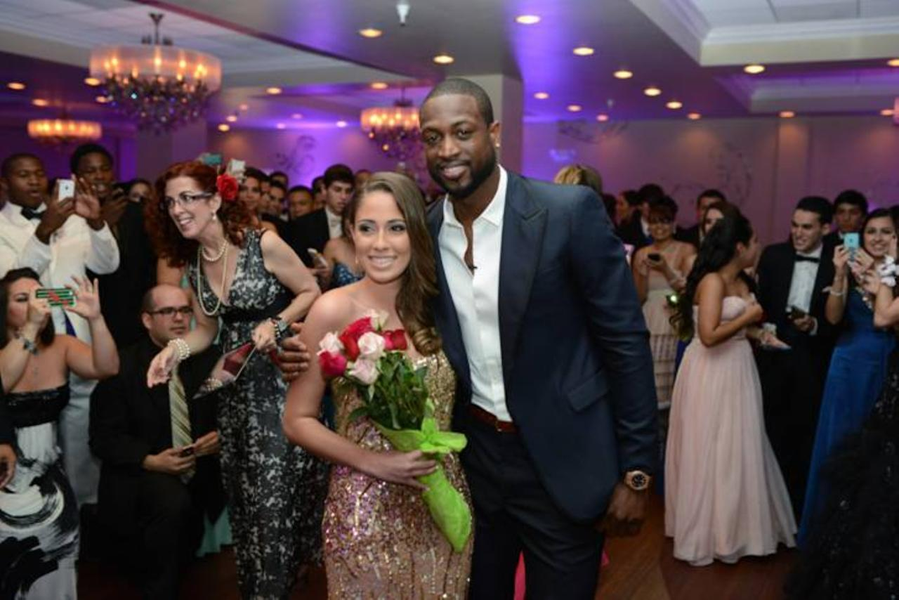 MIAMI - MAY 17:  In this handout photo, Miami Heat player  Dwyane Wade escorts Nicole Muxo to her senior prom at Archbishop Coleman Carroll High School on May 17, 2013 in Miami, Florida. Muxo invited Wade to accompany her to prom via YouTube. (Photo by Bobby Metelus/Getty Images)