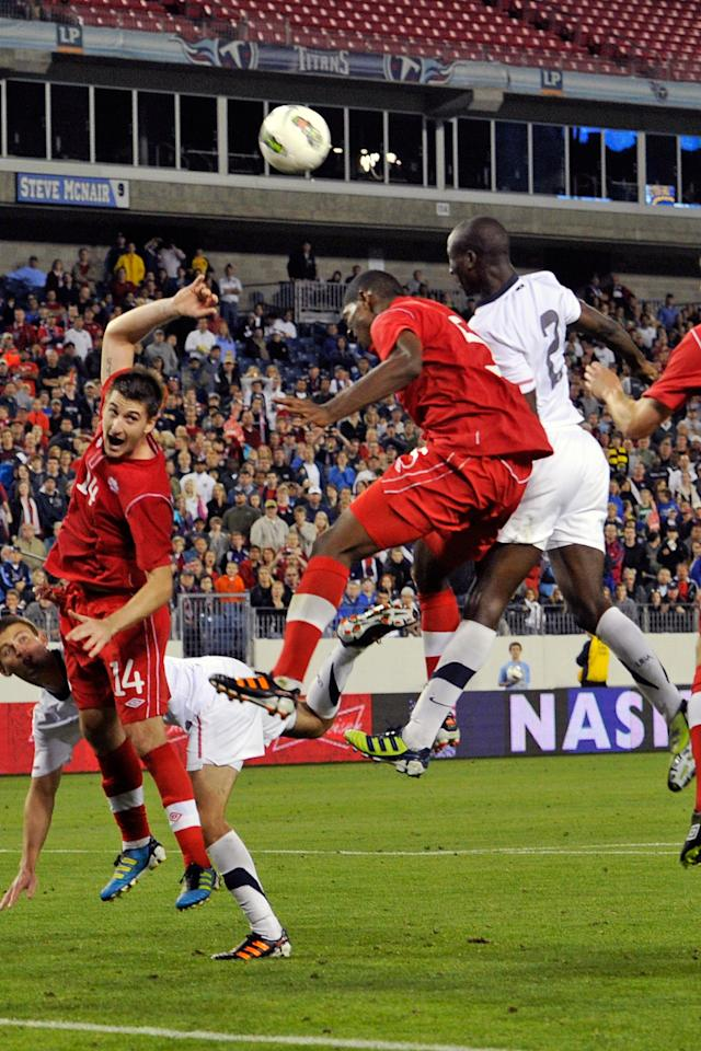 NASHVILLE, TN - MARCH 24:  Doneil Henry #5 of Canada and Ike Opara #2 of the USA jump for a ball in a 2012 CONCACAF Men's Olympic Qualifying match at LP Field on March 24, 2012 in Nashville, Tennessee.  (Photo by Frederick Breedon/Getty Images)