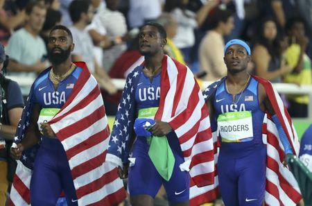 2016 Rio Olympics - Athletics - Final - Men's 4 x 100m Relay Final - Olympic Stadium - Rio de Janeiro, Brazil - 19/08/2016. Mike Rodgers (USA) of USA, Justin Gatlin (USA) of USA and Tyson Gay (USA) of USA after being disqualified.  REUTERS/Lucy Nicholson