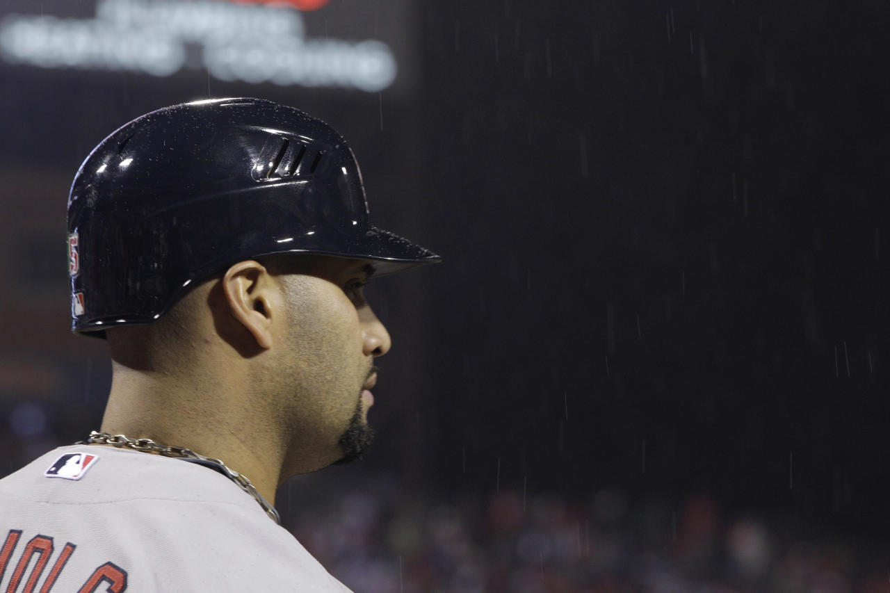 St. Louis Cardinals' Albert Pujols (5) stands in the rain during the seventh inning of Game 2 in baseball's National League division series against the Philadelphia Phillies Sunday, Oct. 2, 2011 in Philadelphia. (AP Photo/Matt Slocum)