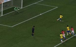 Neymar shoots a penalty shot during the 2014 World Cup against Croatia. (REUTERS)