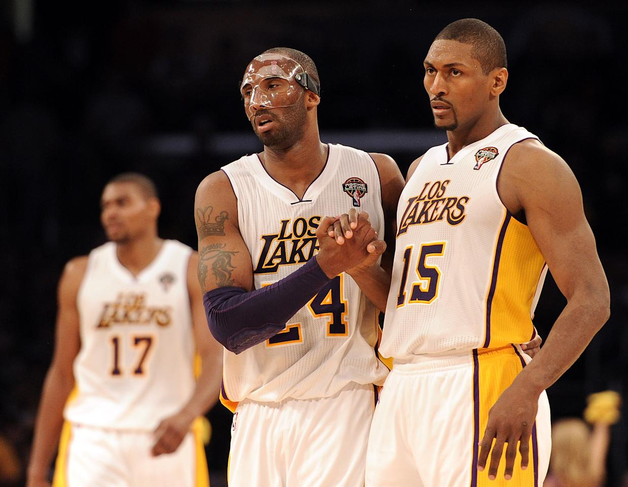LOS ANGELES, CA - MARCH 04:  Kobe Bryant #24 and Metta World Peace #15 of the Los Angeles Lakers celebrate after a stop in play during a 93-83 Laker win at Staples Center on March 4, 2012 in Los Angeles, California.  NOTE TO USER: User expressly acknowledges and agrees that, by downloading and or using this photograph, User is consenting to the terms and conditions of the Getty Images License Agreement.  (Photo by Harry How/Getty Images)