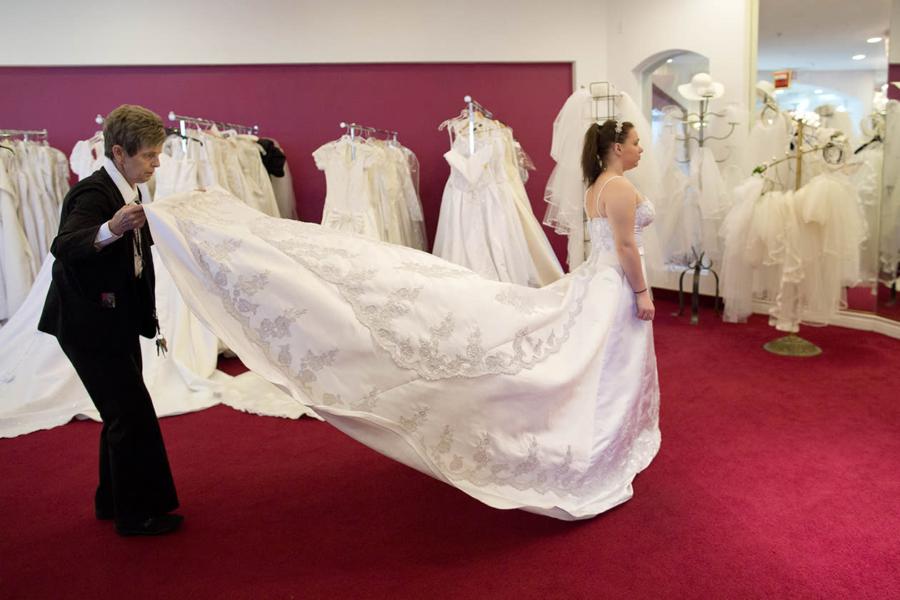 In preparation for her Dec. 12 wedding, Bethany Wood of Jackson, Mich., tries on a wedding gown with the help of Linda de Marre at A Little White Wedding Chapel in Las Vegas.