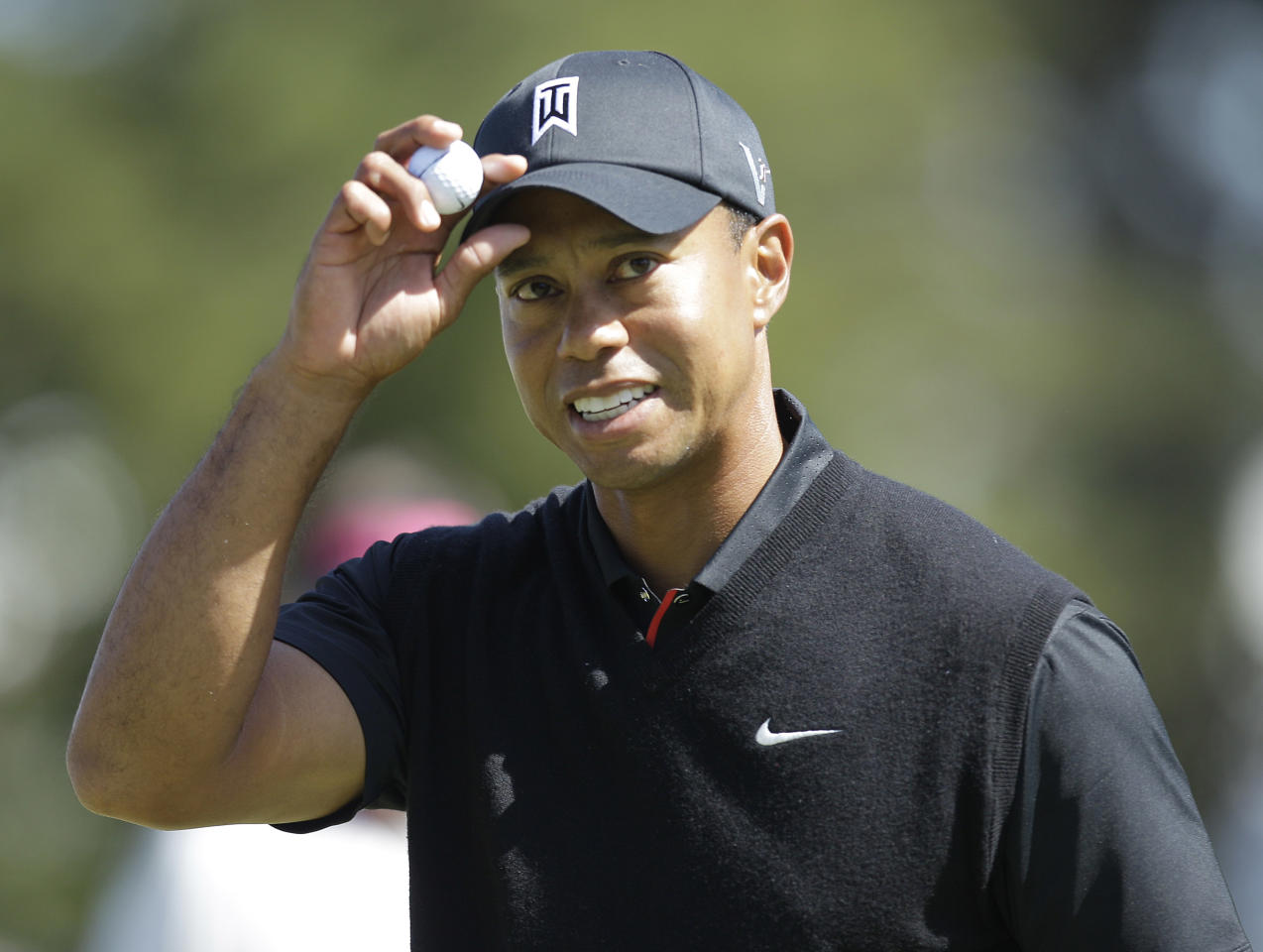 Tiger Woods reacts after making a birdie on the 10th hole during the second round of the U.S. Open Championship golf tournament Friday, June 15, 2012, at The Olympic Club in San Francisco. (AP Photo/Ben Margot)