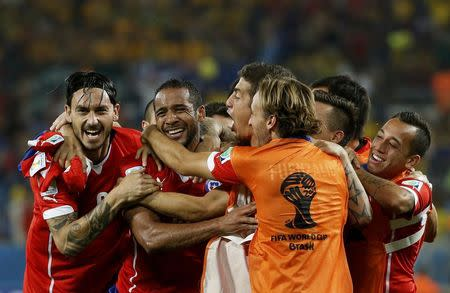 Chile's Beausejour celebrates with teammates after scoring against Australia during their 2014 World Cup Group B soccer match at the Pantanal arena in Cuiaba