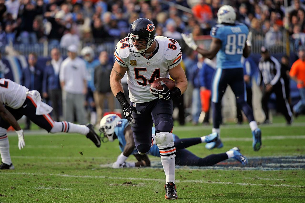 NASHVILLE, TN - NOVEMBER 04:  Brian Urlacher #54 of the Chicago Bears runs back an interception for a touchdown against the Tennessee Titans at LP Field on November 4, 2012 in Nashville, Tennessee.  (Photo by Frederick Breedon/Getty Images)