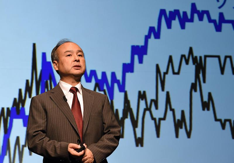 Softbank president Masayoshi Son speaks during a press conference announcing the company's financial results, in Tokyo, on August 8, 2014
