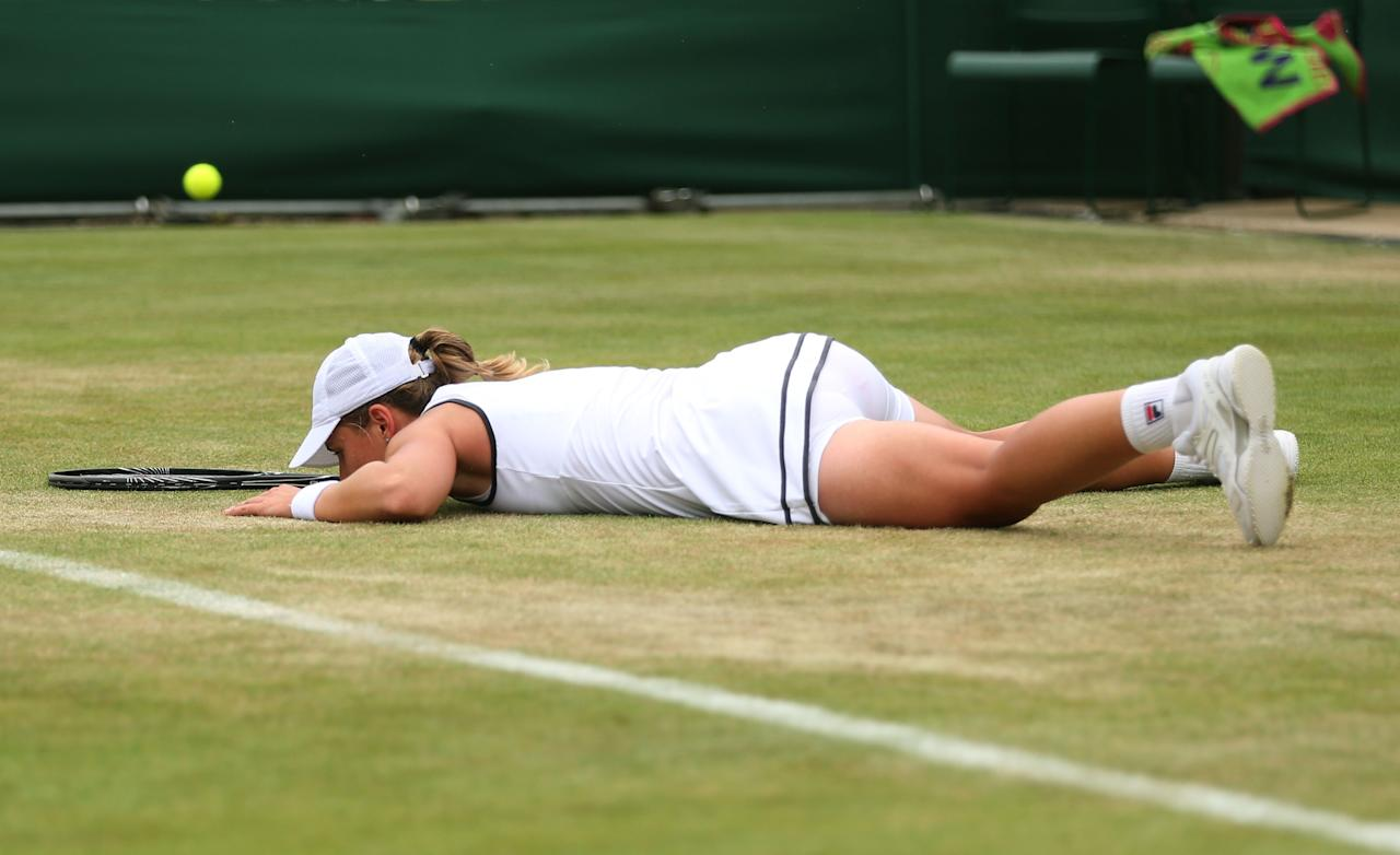 LONDON, ENGLAND - JUNE 27: Marina Erakovic of New Zealand slips on the grass during the Ladies' Singles second round match against Shuai Peng of China on day four of the Wimbledon Lawn Tennis Championships at the All England Lawn Tennis and Croquet Club on June 27, 2013 in London, England. (Photo by Clive Brunskill/Getty Images)
