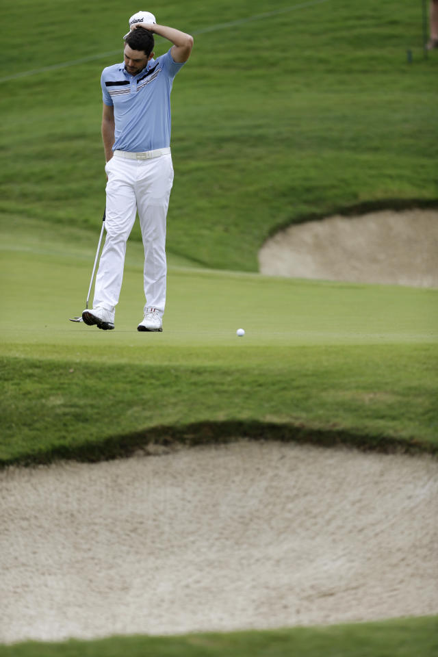 Keegan Bradley scratches his head after leaving a putt short on the first green during the first round of the Byron Nelson Championship golf tournament Thursday, May 16, 2013, in Irving, Texas. Bradley has set the TPC Four Seasons course record with a 10-under par 60 in the opening round (AP Photo/Tony Gutierrez)