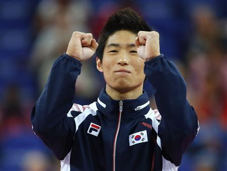Yang Hak Seon of South Korea celebrates winning a gold medal in the men's gymnastics vault final in the North Greenwich Arena during the London 2012 Olympic Games