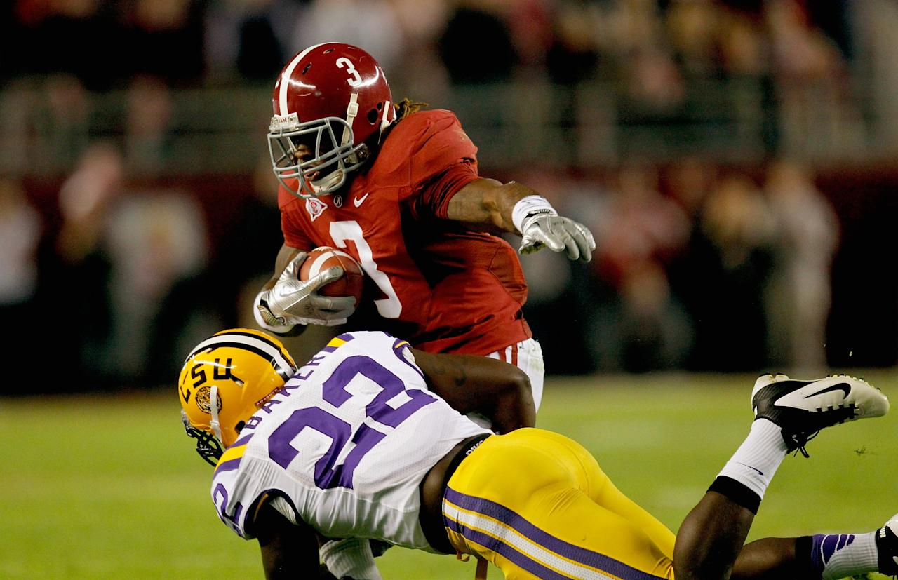 TUSCALOOSA, AL - NOVEMBER 05:  Trent Richardson #3 of the Alabama Crimson Tide makes a catch over Ryan Baker #22 of the LSU Tigers during the first half of the game at Bryant-Denny Stadium on November 5, 2011 in Tuscaloosa, Alabama.  (Photo by Streeter Lecka/Getty Images)