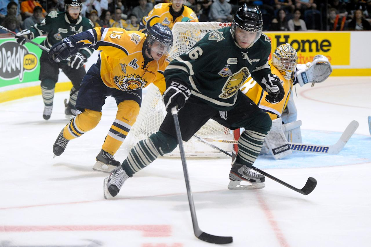 SHAWINIGAN, CANADA - MAY 27:  Max Domi #16 of the London Knights skates with the puck while being chased by Jonathan Narbonne #15 of the Shawinigan Cataractes during the 2012 MasterCard Memorial Cup game at the Bionest Centre on May 27, 2012 in Shawinigan, Quebec, Canada.  (Photo by Richard Wolowicz/Getty Images)