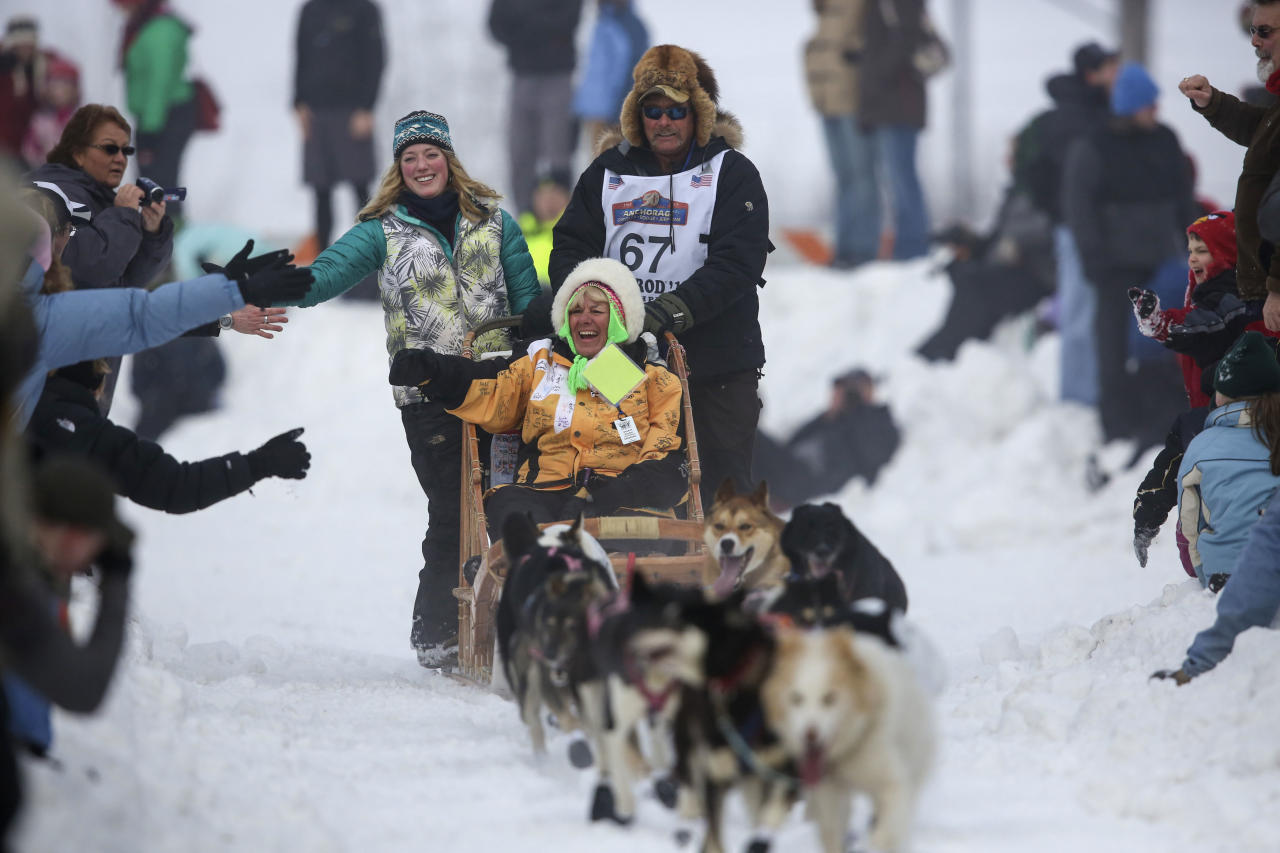 Sonny Lindner's team races down Cordova Street, greeting spectators as they go, during the ceremonial start to the Iditarod dog sled race in downtown Anchorage. The race officially started the day after in Willow, Alaska (Reuters)