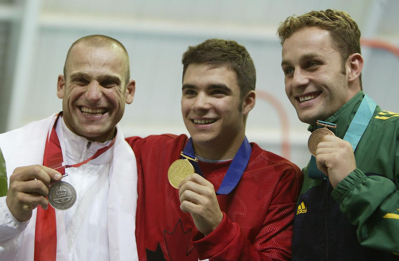 MANCHESTER - JULY 26: Tony Ally of England (L), Alexandre Despatie of Canada (M) and Robert Newbery of Australia with their medals from the Mens 1m Springboard and the Men's 3m Springboard Diving event at the Manchester Aquatics Centre during the 2002 Commonwealth Games in Manchester, England on July 26, 2002. (Photo by Adam Pretty/Getty Images)