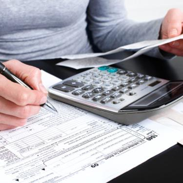Woman-filling-out-tax-forms_web