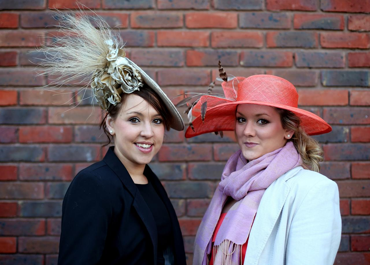 CHELTENHAM, ENGLAND - MARCH 13:  Racegoer Geraldine Murphy (L) and Georgie Turner (R) poses for a photograph as she arrives for Ladies Day at Cheltenham Racecourse on the second day of the Cheltenham Festival 2013 on March 13, 2013 in Cheltenham, England. Approximately 200,000 racing enthusiasts are expected at the four-day festival, which opened today and is seen by many as the highlight of the jump racing calendar.  (Photo by Matt Cardy/Getty Images)