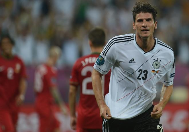 German forward Mario Gomez (R) celebrates after scoring a goal during  the Euro 2012 championships football match Germany vs Portugal  on June 9, 2012 at the Arena Lviv. AFP PHOTO / PATRIK STOLLARZPATRIK STOLLARZ/AFP/GettyImages