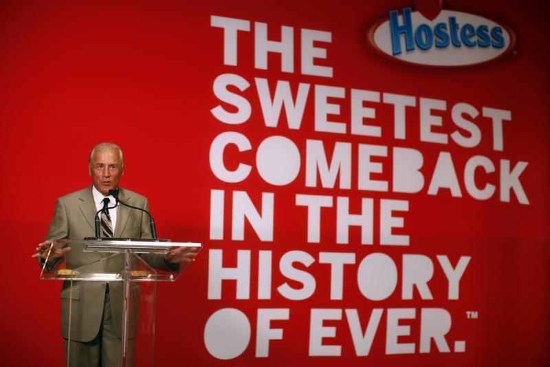 "CEO of Hostess Brands Dean Metropoulos speaks at a ceremony marking the return of ""Twinkies"" at a plant in Schiller Park, Illinois"