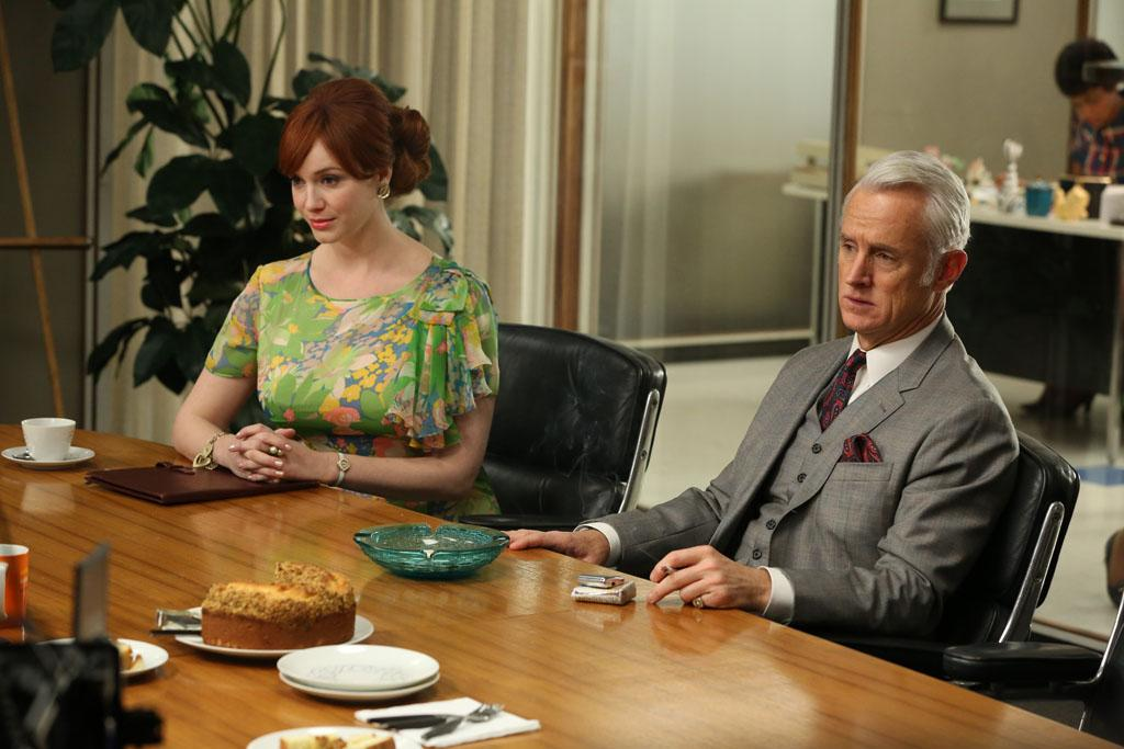 """Joan Harris (Christina Hendricks) and Roger Sterling (John Slattery) in the """"Mad Men"""" episode, """"A Tale of Two Cities."""""""