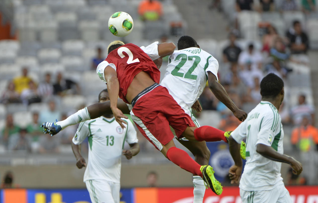 Tahiti's Alvin Tehau, left, and Nigeria's Kenneth Omeruo go for a header during the soccer Confederations Cup group B match between Tahiti and Nigeria in Belo Horizonte, Brazil, Monday, June 17, 2013. (AP Photo/Eugenio Savio)