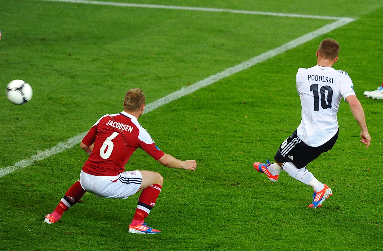 L'VIV, UKRAINE - JUNE 17:  Lukas Podolski of Germany scores their first goal during the UEFA EURO 2012 group B match between Denmark and Germany at Arena Lviv on June 17, 2012 in L'viv, Ukraine.  (Photo by Laurence Griffiths/Getty Images)